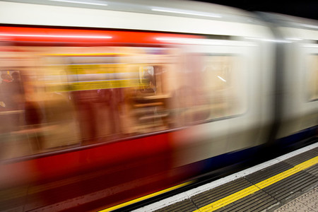 Moving motion blurred train on London Underground