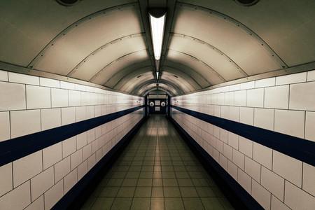 Moody dark tunnel in London Underground train station