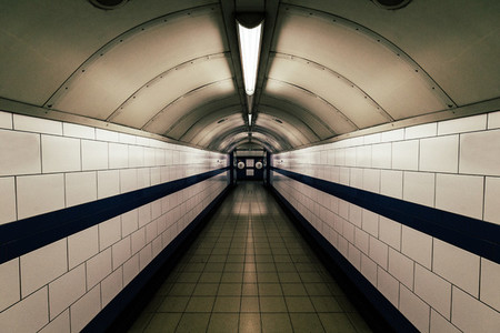 Moody dark tunnel in London Underground train station