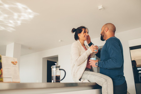 Loving young couple together in kitchen