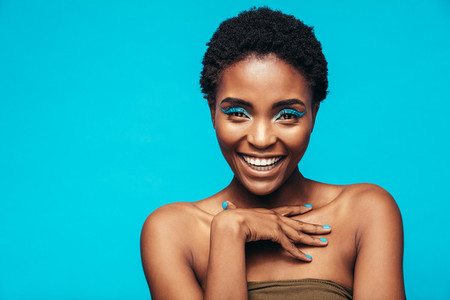 Beauty shot of woman with blue eye shadows