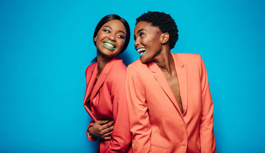 Laughing young women in stylish clothing