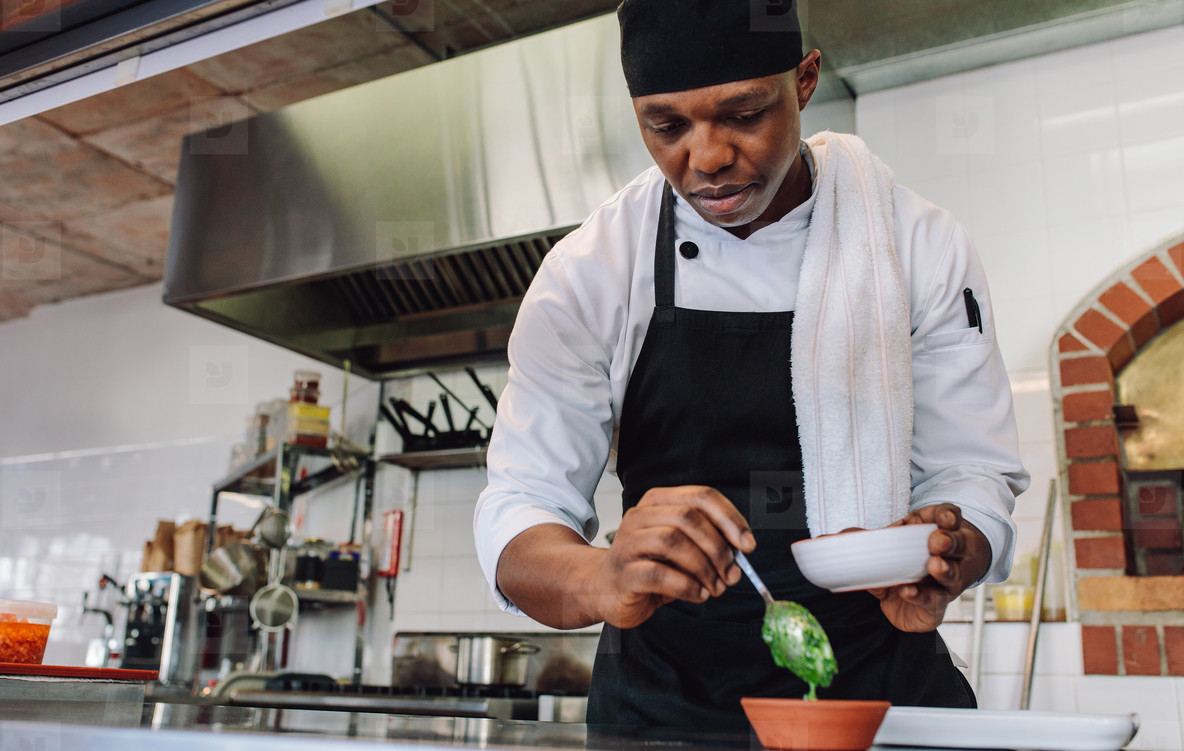 Gourmet chef working at commercial kitchen