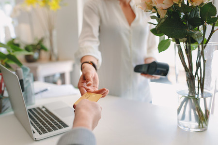 Florist accepting credit card from client