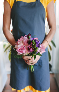 Florist with fresh flower bouquet