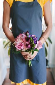 Florist with fresh flower bouquet