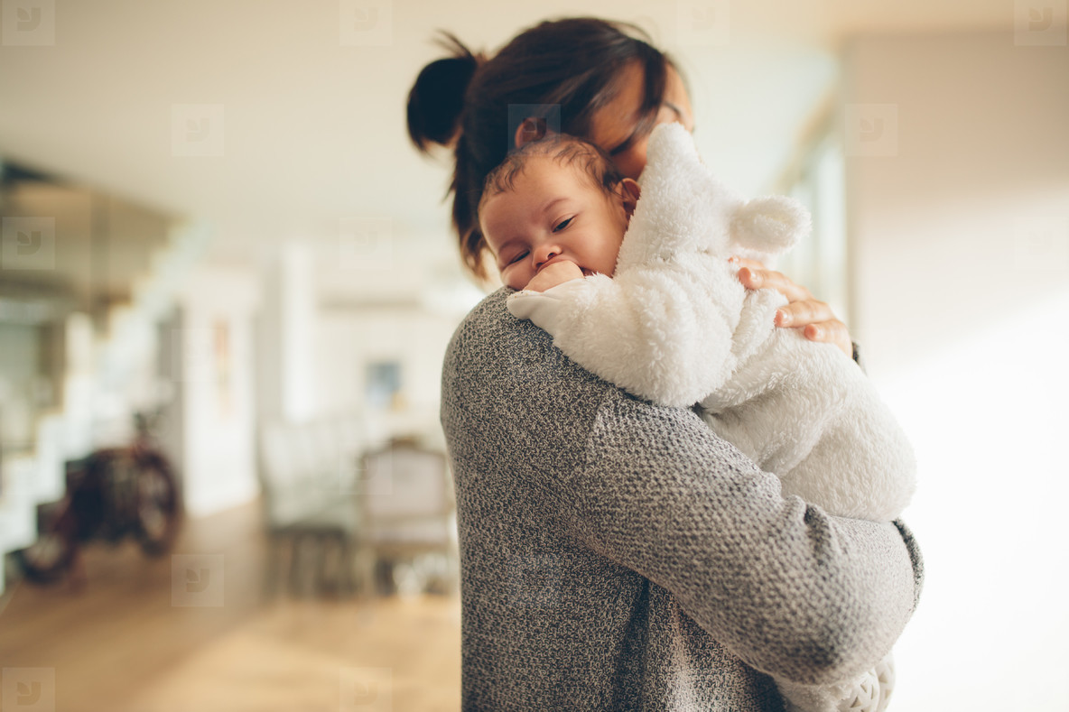 Newborn boy in his mother s arms