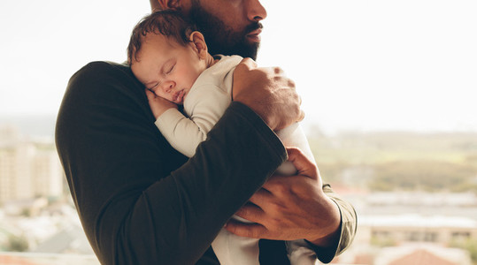 Newborn baby boy in his father039s arms