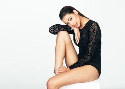 Portrait of a model in black designer clothes