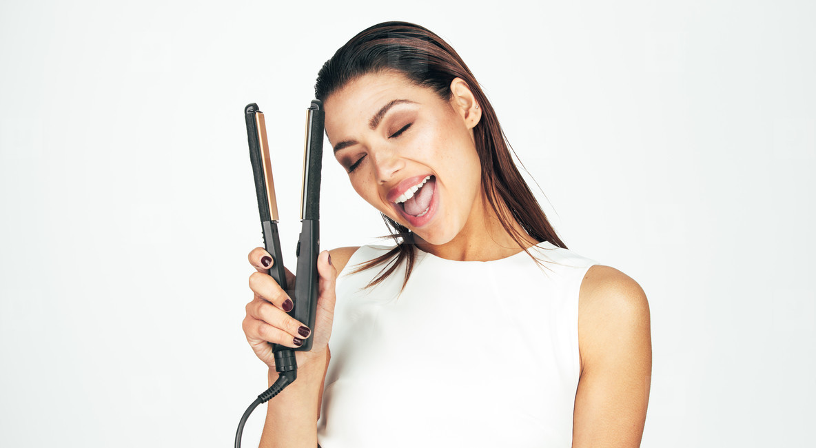 Woman holding a hair straightener
