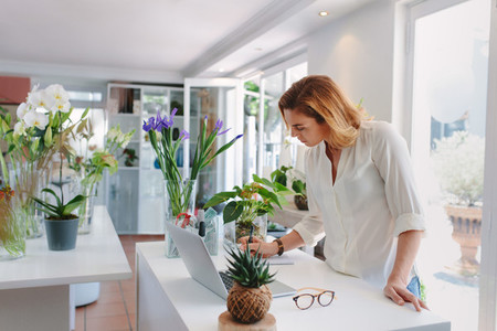 Woman working in plant nursery