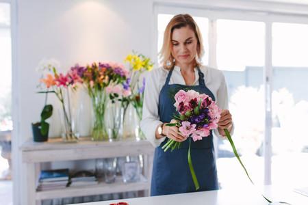 Female florist preparing a bouquet