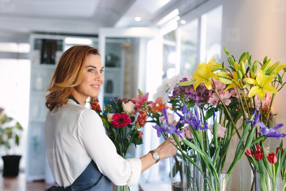 Florist owner making a new floral arrangements