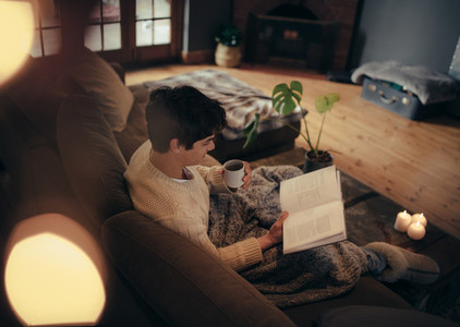 Man sitting at home and reading book