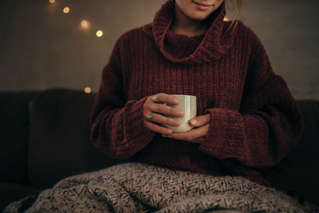 Woman having coffee in winter at home