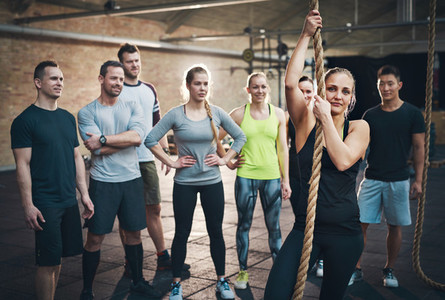 Woman holding climbing rope in cross fit exercises