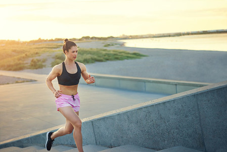 Toned healthy young woman out jogging