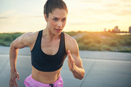 Fit determined young woman runner