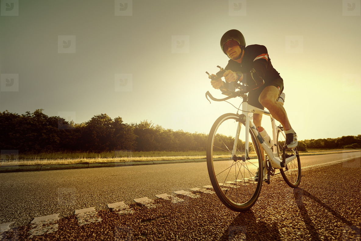 Biking person riding on an empty road