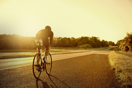 A bike rider in the evening road