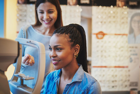 Smiling young black woman ready to take eye exam