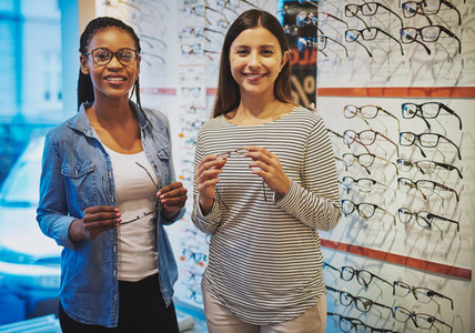 Diverse friends stand together in optical shop