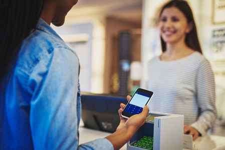 Customer paying with phone and pin pad