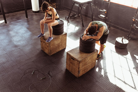Couple resting after intense physical training