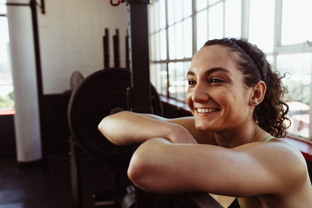 Woman resting after barbell training