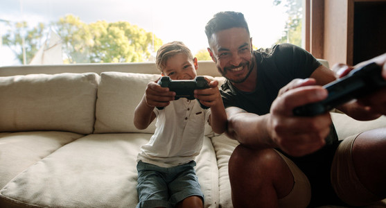Father and son enjoying playing video game