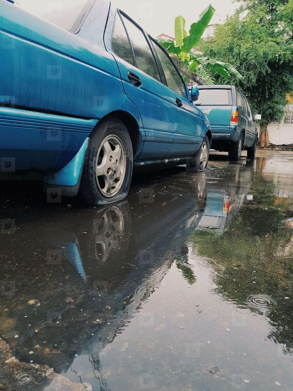 Flat tires of blue car