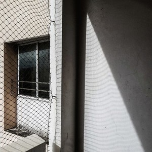 Net shadow on wall