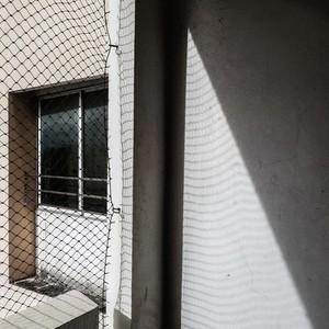 Net shadow on wall