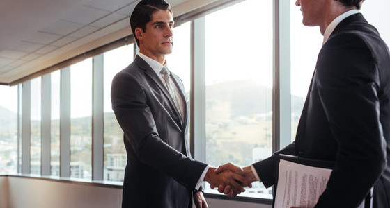 Handshake after a business agreement