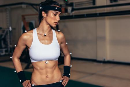 Female athlete with motion capture sensors in biomechanics lab