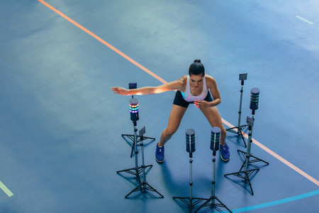 Female athlete with visual stimulus system at gym