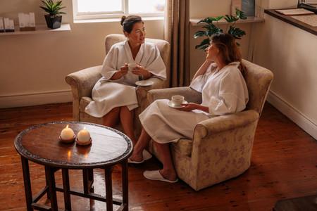 Female friends in spa salon waiting room