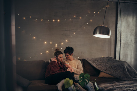 Romantic couple in cozy living room