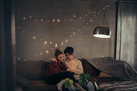 Romantic couple in cozy living room
