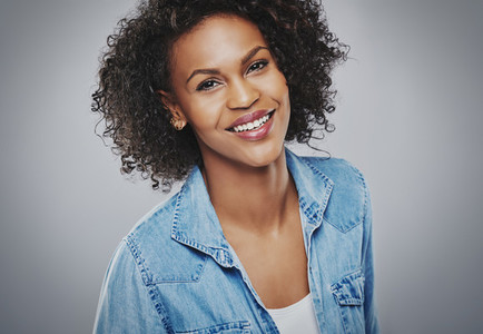Gorgeous smiling woman in blue denim