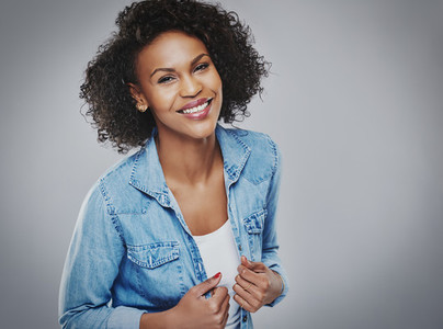 Pretty smiling woman in blue denim