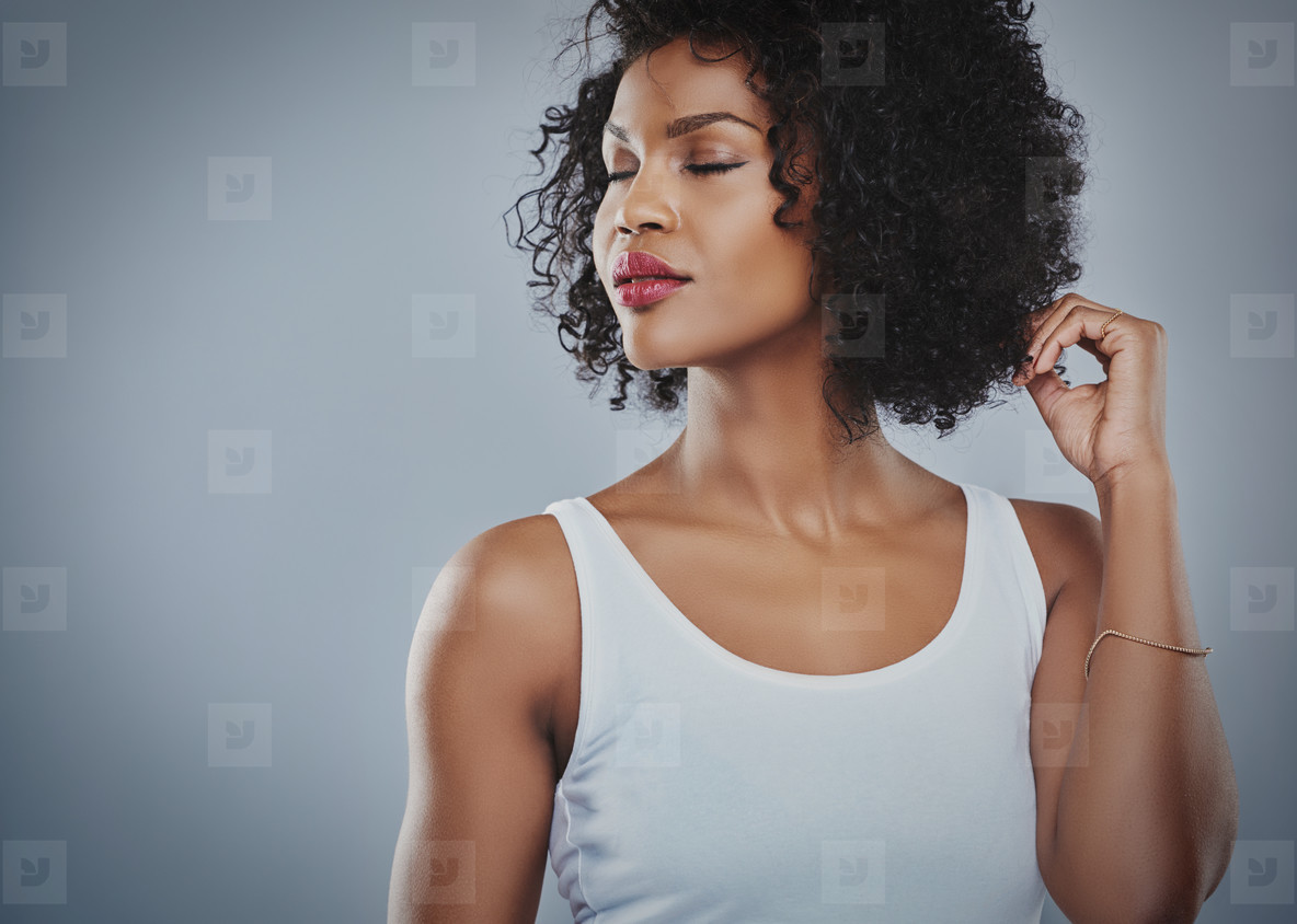 Young woman with eyes closed looking to side