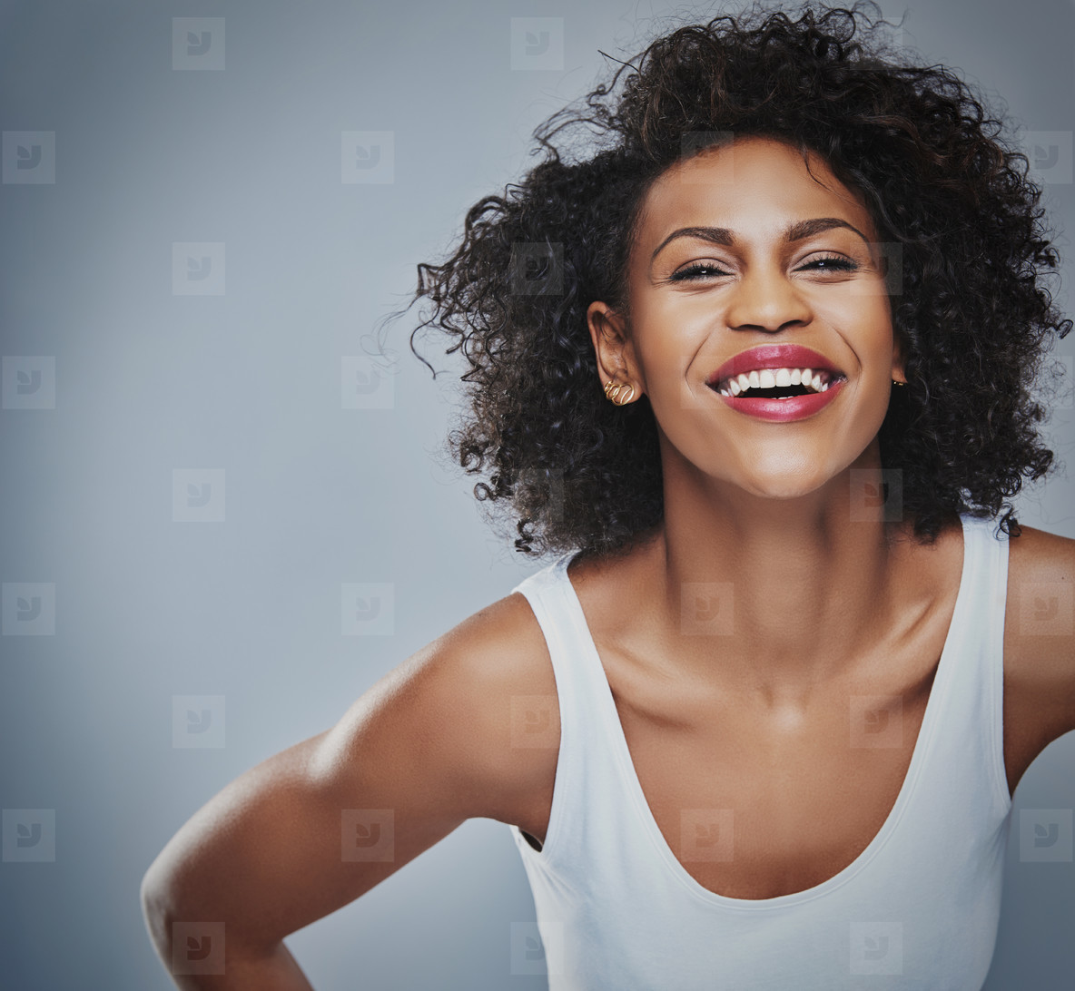 Laughing female leaning forward with copy space