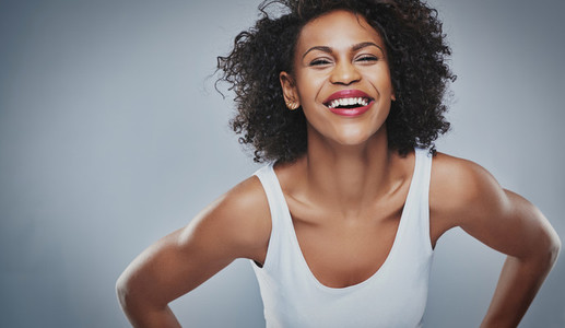 Young woman leaning inward and laughing