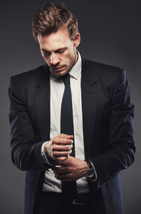Businessman adjusting his cuff or cufflink