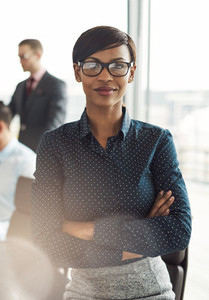 Female business executive with folded arms