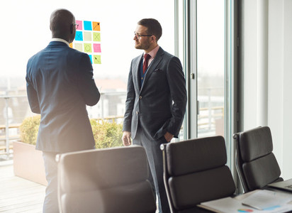 Two business man standing having a discussion