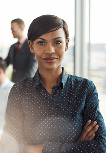 Confident young business woman in office