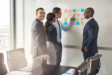 Group of business people with sticky notes
