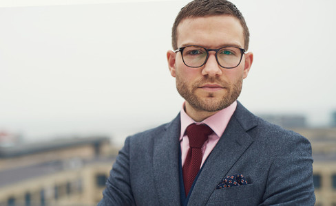 Serious intense young businessman with glasses